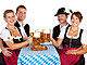 Bavarian men and women toast with Oktoberfest beer stein